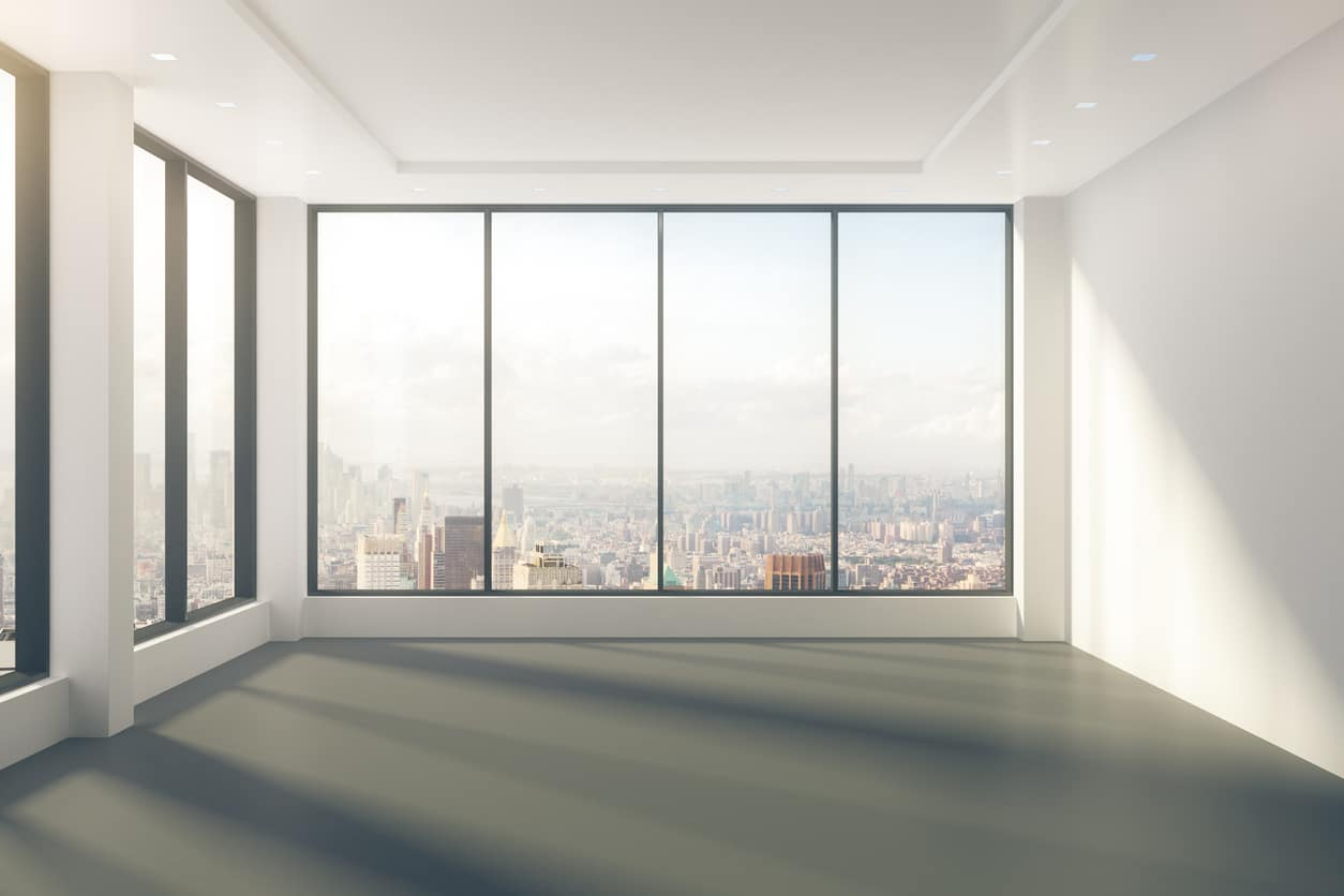 Modern empty room with windows in floor and city view