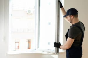Handyman fixing the window