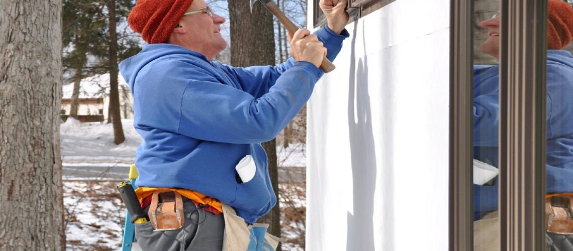 Man installing windows in addition