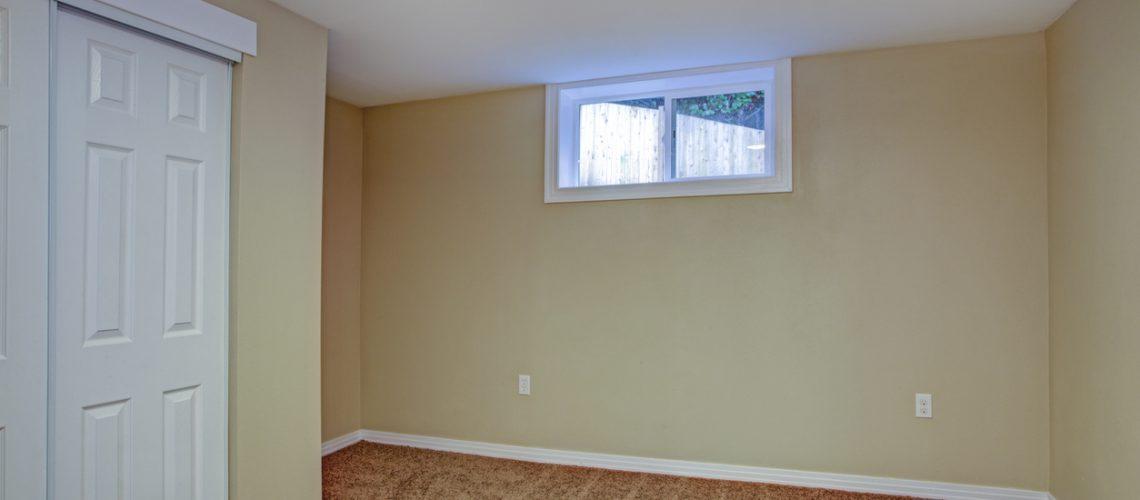 Empty room, sand beige walls, carpet floor in a luxury home.