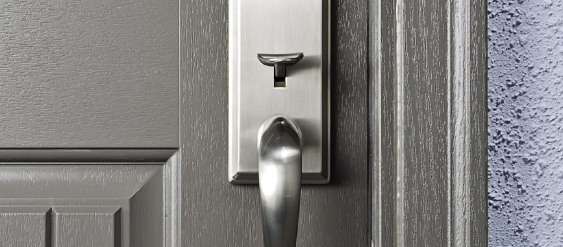 Fiberglass door with lock set and brick moulding.